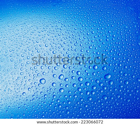 Water droplets on a blue background. Drops of water.