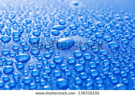 Water droplets on a blue metal background - stock photo
