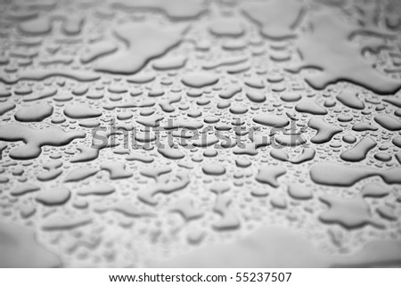 Water droplets on a silver background with shallow depth of focus - stock photo