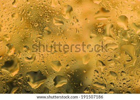 Water droplets on glass,Bright color background - stock photo