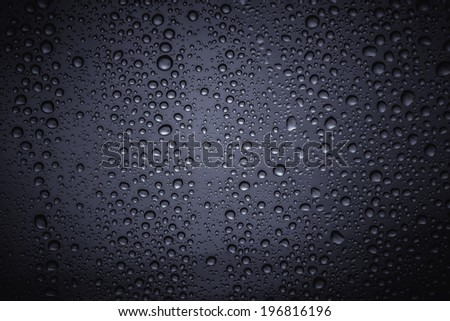 Water droplets on the glass with a colored background - stock photo