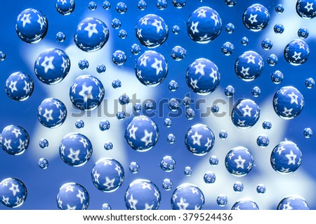 Water droplets with stars on a blue background
