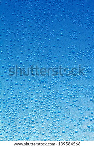 Water drops on a blue glass background - stock photo