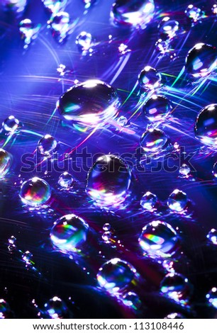 Water drops on a CD - stock photo