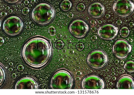 Water drops on a dark green glass close up - stock photo
