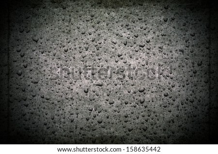 Water drops on a paper surface                                - stock photo