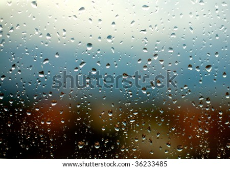 Water drops on a window glass. - stock photo
