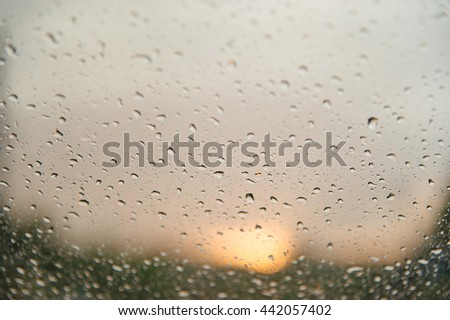 Water drops on a window glass after the rain with sunlight  background. - stock photo