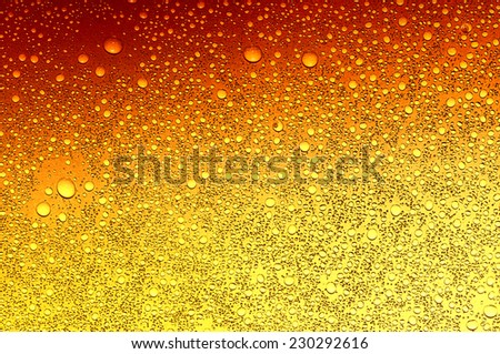 water drops on beer background  - stock photo