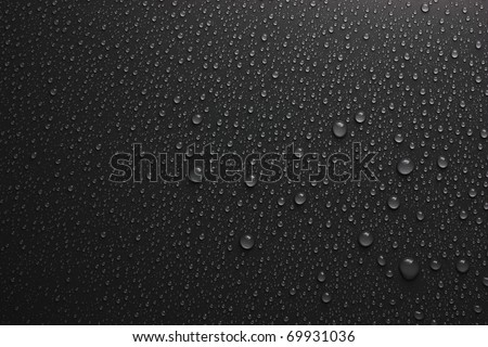 water drops on black - stock photo