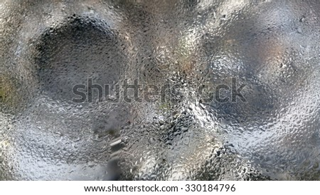Water drops on car lamp. - stock photo