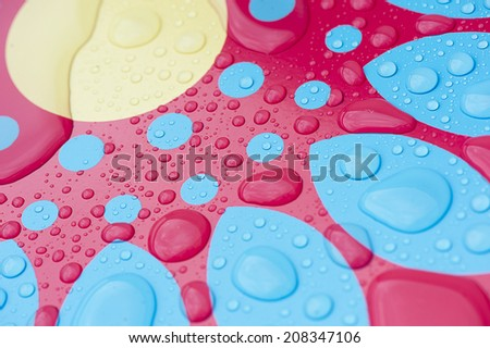 Water drops on colored surface - stock photo