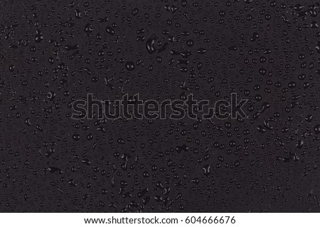 Water drops on dark stone surface texture background
