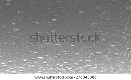 Water drops on glass in monochrome