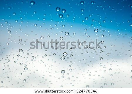 Water drops on glass ,Movement of water drop on glass ,Out of focus water drop movement background - stock photo