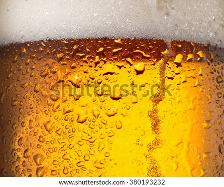 Water drops on glass of beer. Close up. - stock photo