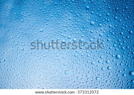 Water drops on glass surface texture. - stock photo