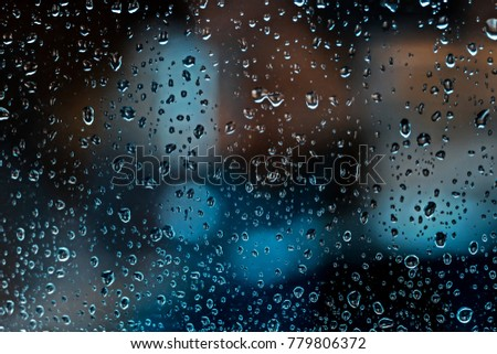 Water drops on glass textured dark background nature