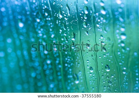 Water drops on glass with selective focus - stock photo