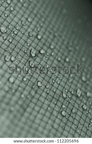Water drops on gray tiles