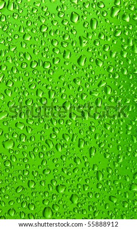 Water drops on green - stock photo