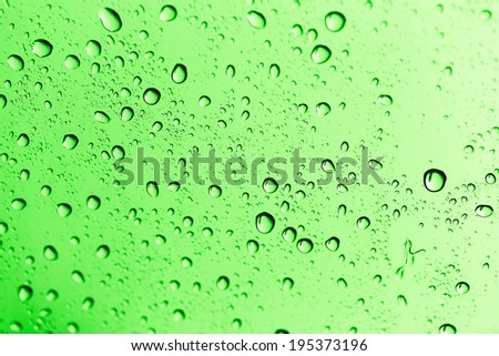 water drops on green glass - stock photo