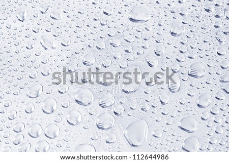 Water drops on metal background. Toned image - stock photo