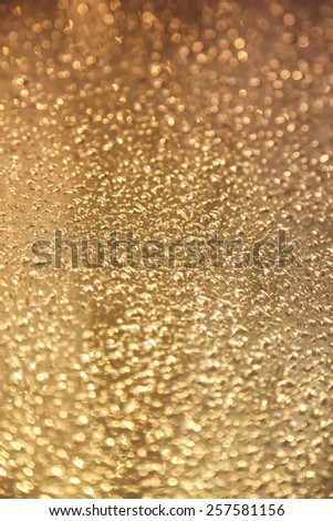 Water drops on metal background with reflection blurred on the edges. Image processing with color filter effect - stock photo