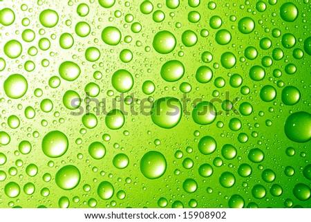 Water drops on metallic surface - stock photo
