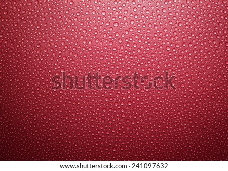 Water Drops on red metallic surface. - stock photo
