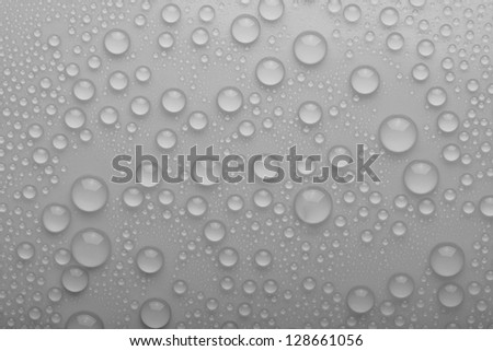 Water drops on silver background - stock photo