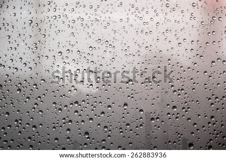 Water drops on sweaty window glass. - stock photo