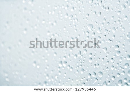 Water drops on the glass - stock photo