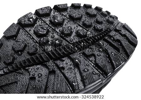 water drops on the soles of shoes - stock photo