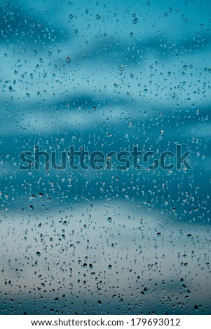 Water drops on the window after a storm - stock photo