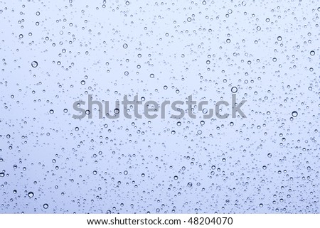 Water drops on the window. Water collection. - stock photo