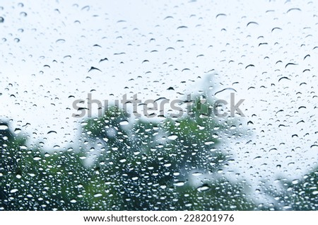 water drops on window after rain filtered background. - stock photo