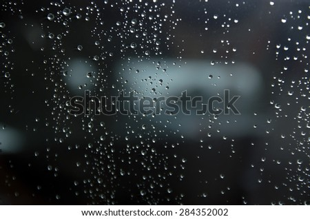 water drops on window after rain filtered background.