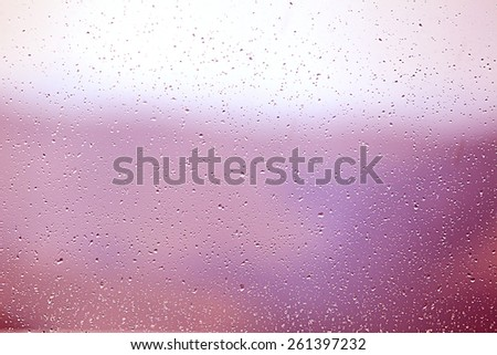 water drops on window at sunset - stock photo