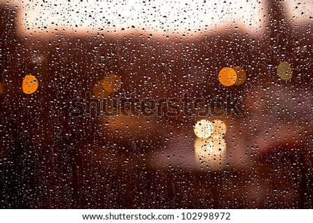 water drops on window by evening - stock photo