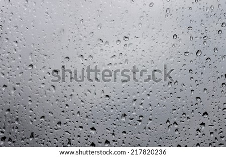 Water drops on window glass after rain - stock photo