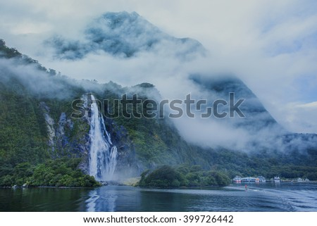 water falls in milford sound important traveling destination in fiordland national park south island new zealand - stock photo