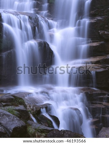 Water falls in waterfall, beauty in nature. - stock photo