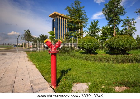 Water Fire Hydrant Red color on the green field - stock photo