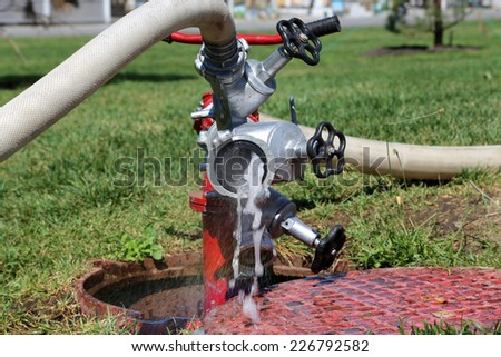 water flow coming out from a fire hydrant   - stock photo