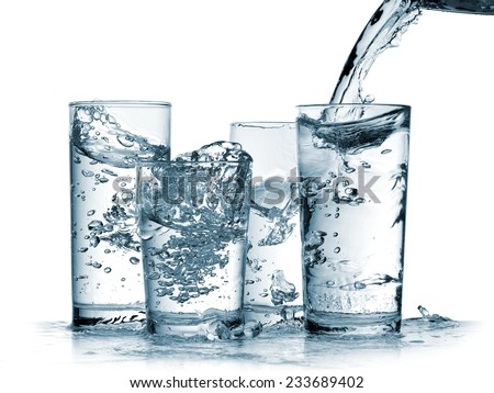 Water flow in four glasses - stock photo