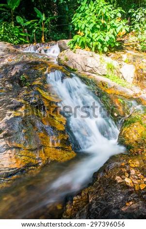 Water Flowing at Mae Kampong Waterfall, Thailand. - stock photo