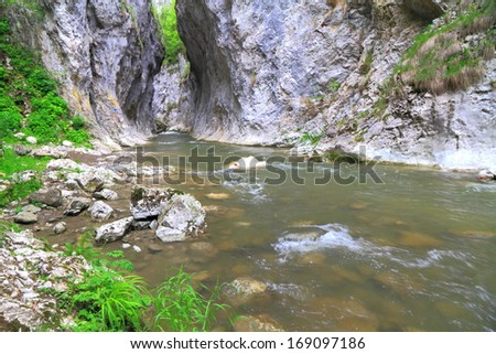 Water flowing between tall limestone gorge walls  - stock photo