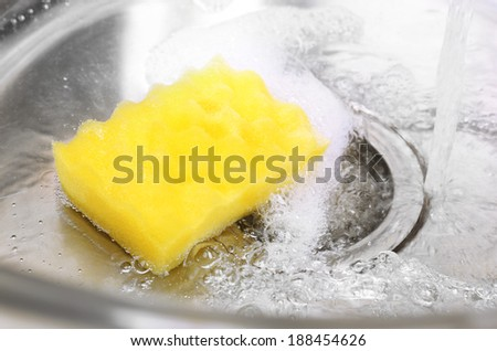 Water flowing down hole in kitchen sink - stock photo