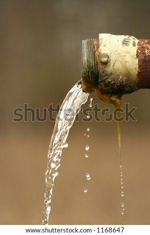 Water Flowing from Pipe - stock photo